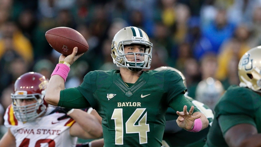 Baylor quarterback Bryce Petty (14) passes under pressure from Iowa State 's Cory Morrissey (48) in the first half of an NCAA college football game, Saturday, Oct. 19, 2013, in Waco, Texas. (AP Photo/Tony Gutierrez)