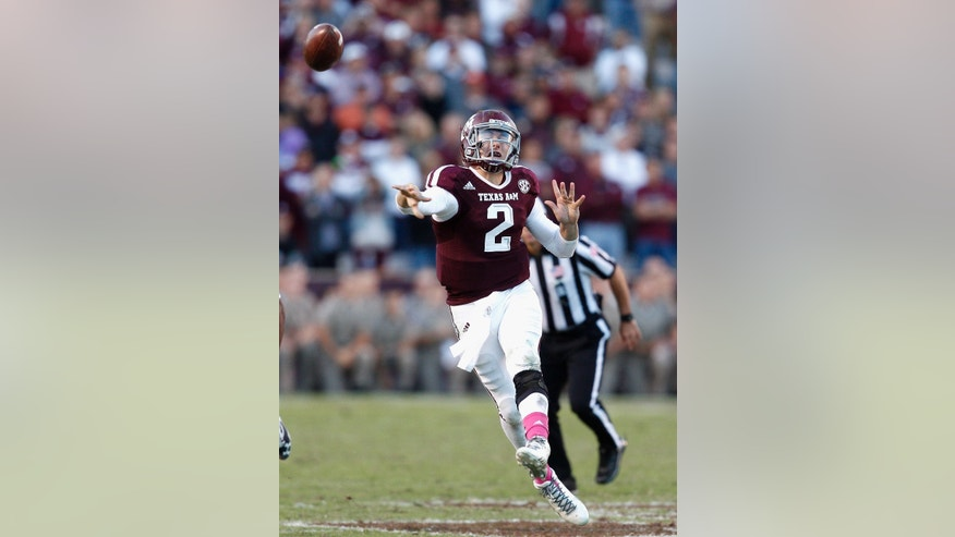 Texas A&M quarterback Johnny Manziel (2) throws on the run into the end zone in the fourth quarter for an incomplete pass against Auburn during an NCAA college football game Saturday, Oct. 19, 2013, in College Station, Texas. Auburn won 45-41. (AP Photo/Bob Levey)