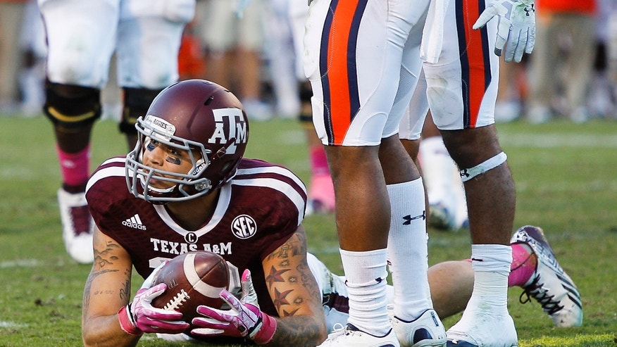 Texas A&M wide receiver Mike Evans (13) comes up short of the goal line in the fourth quarter against Auburn in an NCAA college football game Saturday, Oct. 19, 2013, in College Station, Texas. Auburn won 45-41. (AP Photo/Bob Levey)
