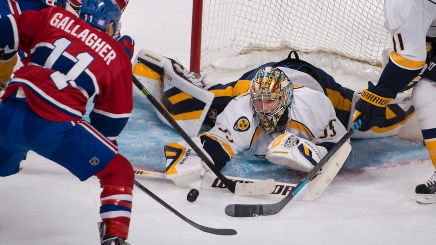 Montreal Canadiens' Brendan Gallagher tries to put the puck past Nashville Predators goalie Pekka Rinne during the second period of an NHL hockey game, Saturday, Oct. 19, 2013 in Montreal. (AP Photo/The Canadian Press, Peter McCabe)