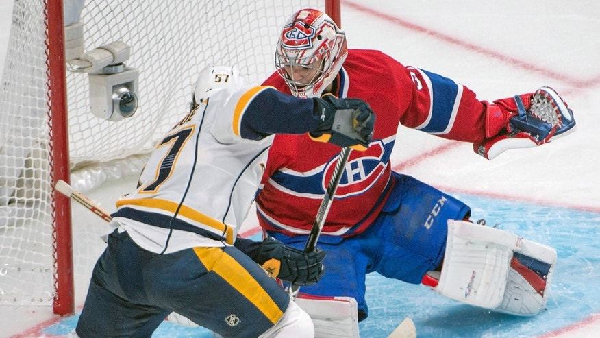Nashville Predators' Gabriel Bourque tries to get the puck past Montreal Canadiens' Carey Price during the second period of an NHL hockey game, Saturday, Oct. 19, 2013 in Montreal. (AP Photo/The Canadian Press, Peter McCabe)