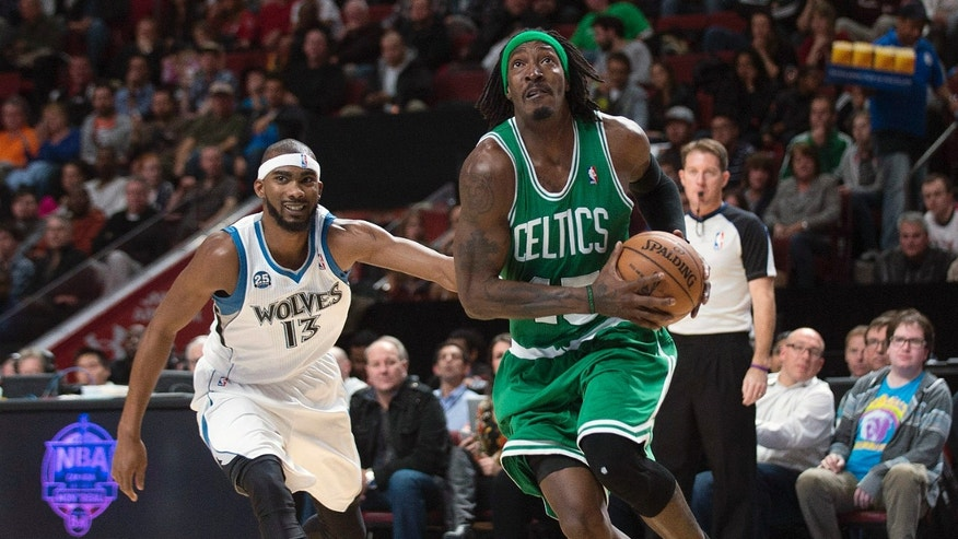 Boston Celtics' Gerald Wallace, right, drives to the net as Minnesota Timberwolves' Corey Brewer defends during first quarter of an NBA preseason basketball game in Montreal, Sunday, Oct. 20, 2013. (AP Photo/The Canadian Press, Graham Hughes)