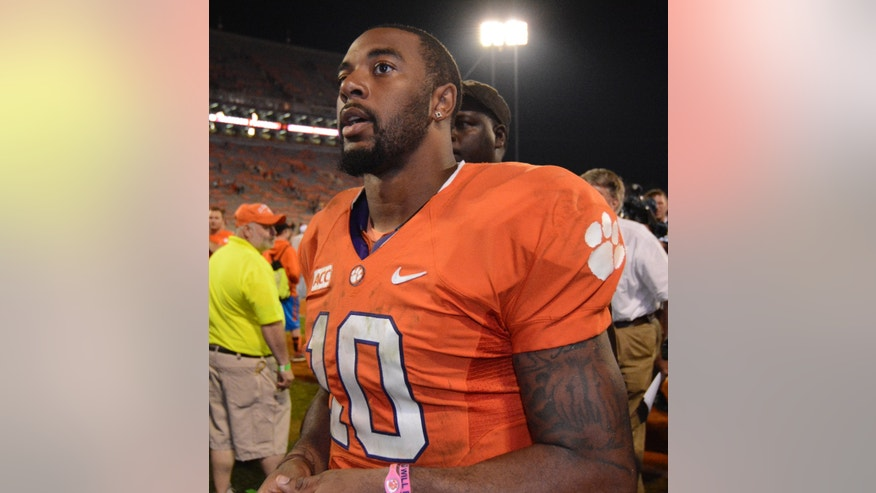 Clemson quarterback Tajh Boyd (10) walks of the field after the second half of an NCAA college football game against Florida State, Sunday, Oct. 20, 2013, in Clemson, S.C. Florida State won 51-14. (AP Photo/Richard Shiro)
