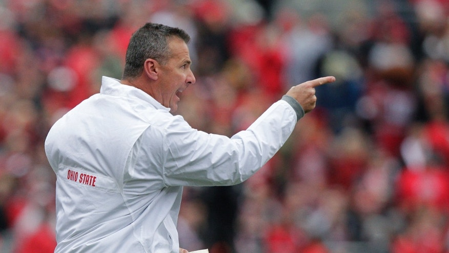 Ohio State head coach Urban Meyer yells on the sideline in the first quarter against Iowa during an NCAA college football game Saturday, Oct. 19, 2013, in Columbus, Ohio. (AP Photo/Jay LaPrete)