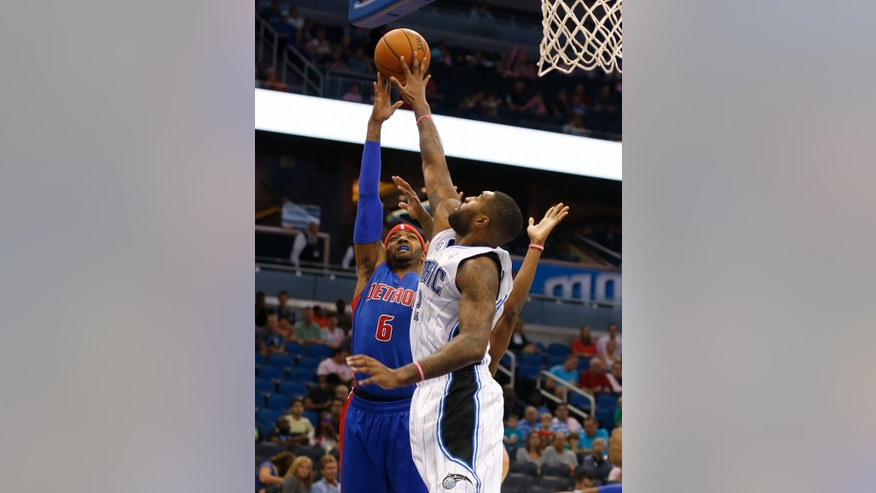 Detroit Pistons forward Josh Smith (6) shoots over Orlando Magic forward Kyle O'Quinn (2) during the first half of an NBA basketball game on Sunday,  Oct.  20, 2013, in Orlando, Fla. (AP Photo/Reinhold Matay)