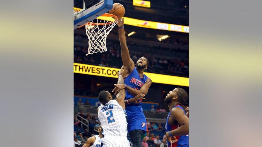 Orlando Magic forward Kyle O'Quinn (2) tries to block the shot by Detroit Pistons center Andre Drummond  during the first half of an NBA basketball game on Sunday,  Oct.  20, 2013 in Orlando, Fla.. (AP Photo/Reinhold Matay)
