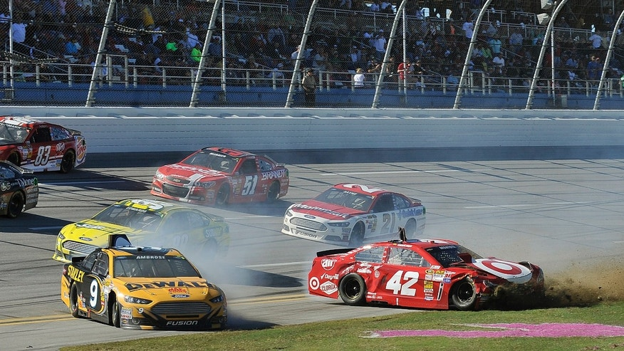 Sprint Cup Series driver Juan Pablo Montoya (42) slides through the tri-oval after being hit by driver Marcos Ambrose (9) during the NASCAR Sprint Cup Series auto race at the Talladega Superspeedway in Talladega, Ala., Sunday, Oct. 20, 2013. (AP Photo/Padriac Major)