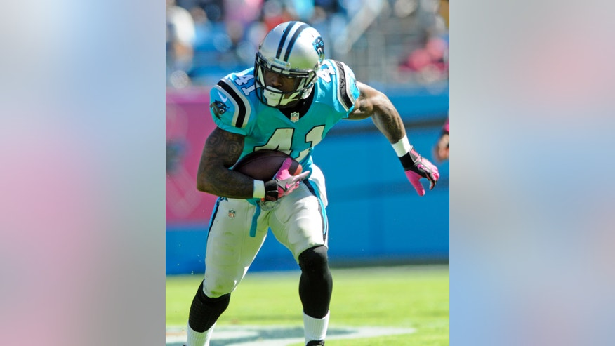 Carolina Panthers' Captain Munnerlyn (41) returns an interception for a touchdown against the St. Louis Rams in the first half of an NFL football game in Charlotte, N.C., Sunday, Oct. 20, 2013. (AP Photo/Mike McCarn)