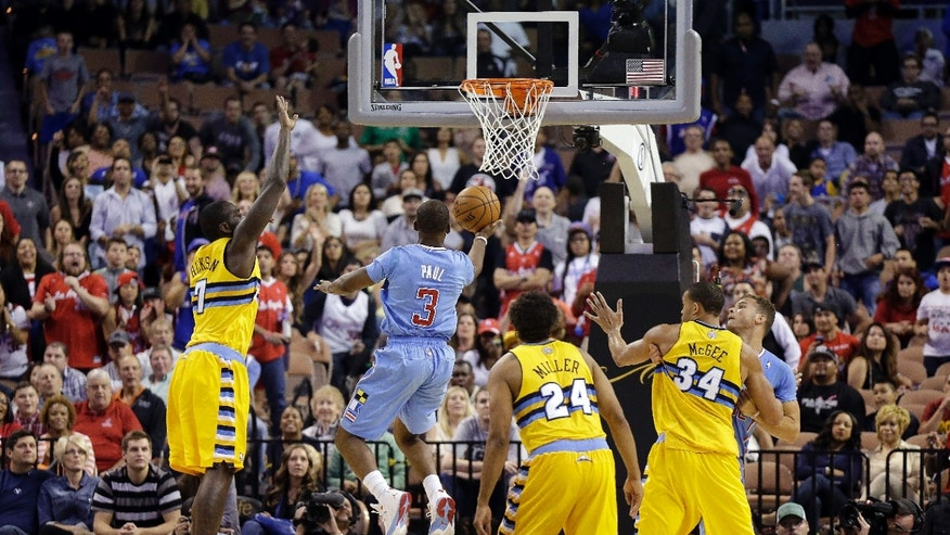 The Los Angeles Clippers' Chris Paul sinks a game-tying shot during the final seconds of the second half of a preseason NBA basketball game against the Denver Nuggets on Saturday, Oct. 19, 2013, in Las Vegas. The Clippers went on to defeat the Nuggets in overtime 118-111. (AP Photo/Isaac Brekken)