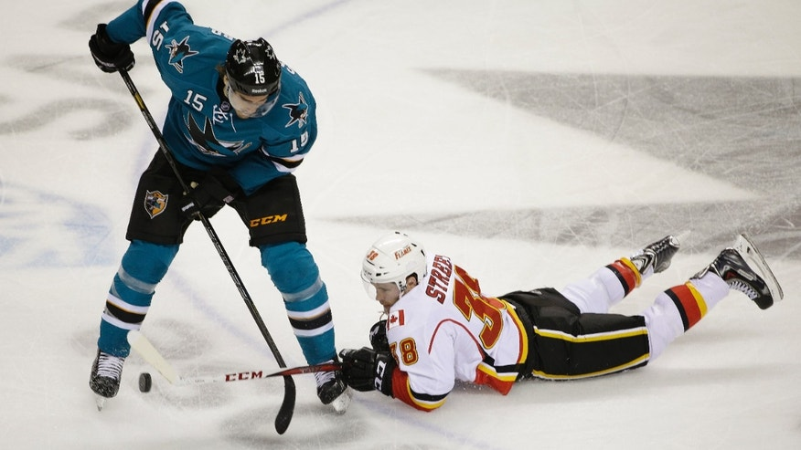 San Jose Sharks center James Sheppard, left, battles for the puck with Calgary Flames right wing Ben Street, right, during the first period of an NHL hockey game Saturday, Oct. 19, 2013, in San Jose, Calif. (AP Photo/Eric Risberg)