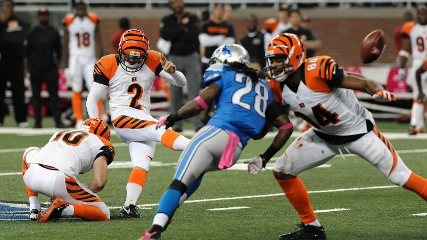 Cincinnati Bengals kicker Mike Nugent (2) kicks a 54-yard field goal against the Detroit Lions in the fourth quarter of an NFL football game Sunday, Oct. 20, 2013, in Detroit. Cincinnati beat Detroit Lions 27-24. (AP Photo/Jose Juarez)
