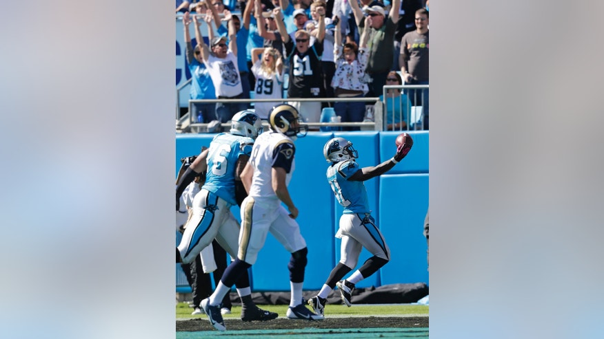 Carolina Panthers' Captain Munnerlyn (41) celebrates his interception return for a touchdown against the St. Louis Rams in the first half of an NFL football game in Charlotte, N.C., Sunday, Oct. 20, 2013. (AP Photo/Chuck Burton)