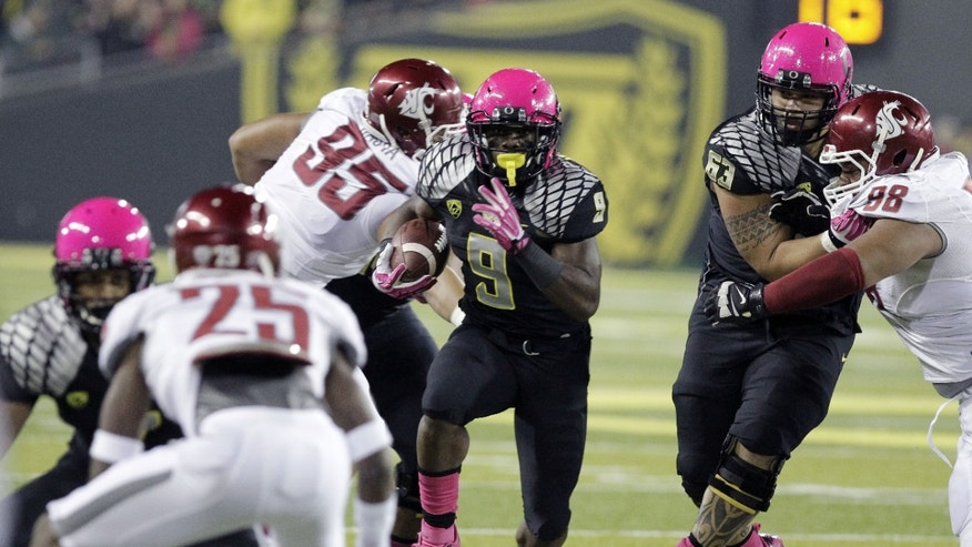 Oregon running back Byron Marshall (9) runs for a touchdown during the first half of an NCAA college football game against Washington State in Eugene, Ore., Saturday, Oct. 19, 2013. (AP Photo/Don Ryan)