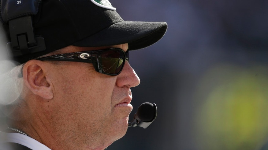 New York Jets head coach Rex Ryan stands on the sideline during the second half of an NFL football game against the New England Patriots on Sunday, Oct. 20, 2013, in East Rutherford, N.J.  (AP Photo/Seth Wenig)