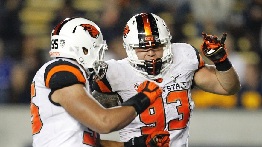 Oregon State defensive end Scott Crichton (95) and defensive tackle Mana Rosa (93) celebrate after recovering a fumble by California quarterback Jared Goff (16) during the first quarter of an NCAA college football game in Berkeley, Calif., Saturday, Oct. 19, 2013. (AP Photo/Tony Avelar)