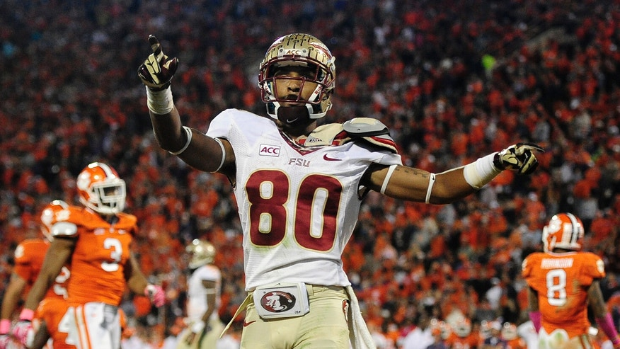 Florida State wide receiver Rashad Greene (80) celebrates after scoring a touchdown against the Clemson during the second half of an NCAA college football game, Saturday, Oct. 19, 2013, in Clemson, S.C. (AP Photo/Richard Shiro)