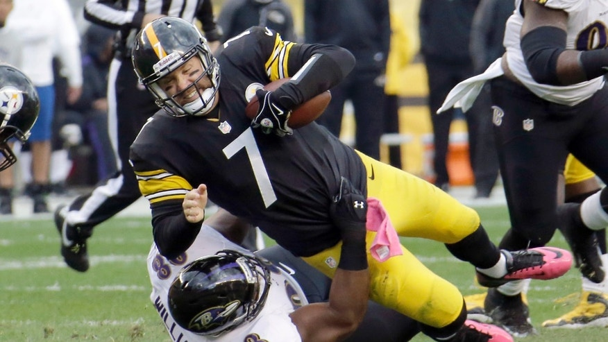 Pittsburgh Steelers quarterback Ben Roethlisberger (7) is sacked by Baltimore Ravens defensive tackle Brandon Williams (98) in the second quarter of an NFL football game in Pittsburgh on Sunday, Oct 20, 2013. (AP Photo/Gene J. Puskar)