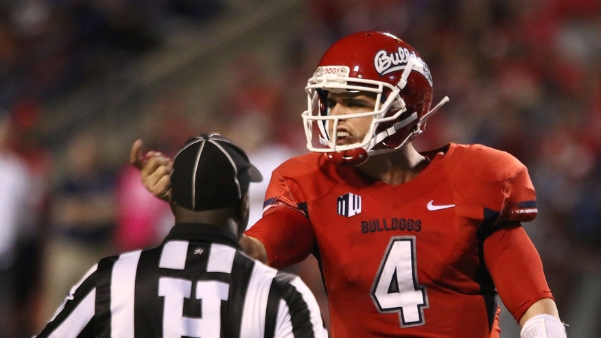 Fresno State' quarterback Derek Carr (4) yells at the UNLV bench during the first half of an NCAA college football game Saturday, Oct. 19, 2013, in Fresno, Calif. (AP Photo/Gary Kazanjian)