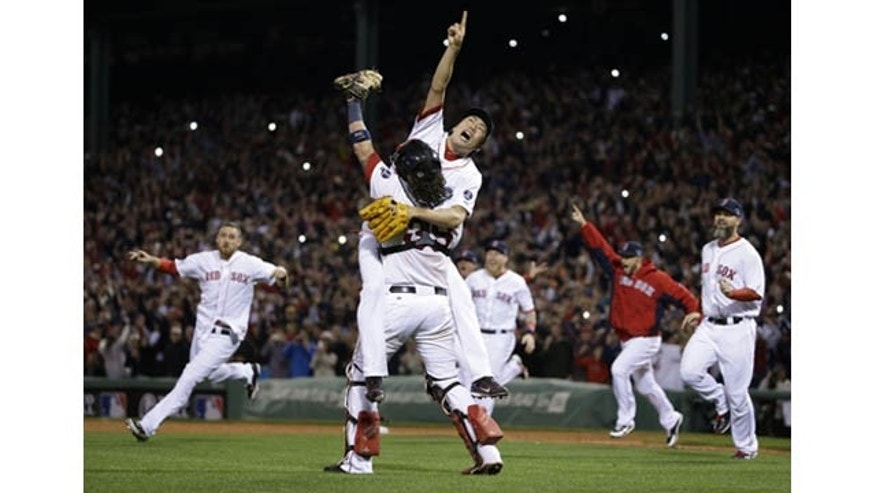 October 19, 2013: Boston Red Sox relief pitcher Koji Uehara, rear, and catcher Jarrod Saltalamacchia celebrate the Red Sox 5-2 win over the Detroit Tigers in Game 6 of the American League baseball championship series on Saturday, Oct. 19, 2013, in Boston. (AP Photo)