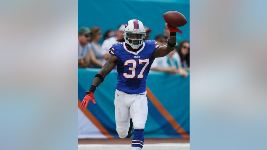 Buffalo Bills defensive back Nickell Robey (37) shows off the ball after he intercepted a pass by Miami Dolphin's quarterback Ryan Tannehill for a touchdown and during the first half of an NFL football game, Sunday, Oct. 20, 2013, in Miami Gardens, Fla. (AP Photo/Lynne Sladky)