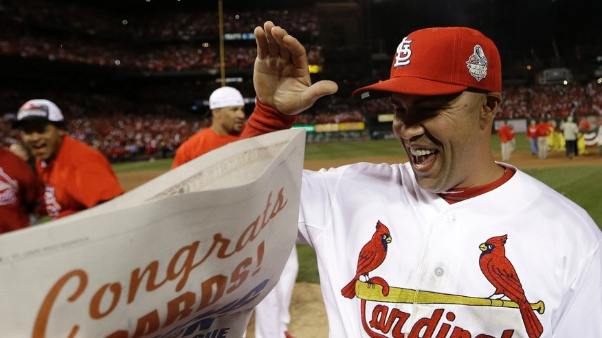 St. Louis Cardinals' Carlos Beltran celebrates after Game 6 of the National League baseball championship series against the Los Angeles Dodgers, Friday, Oct. 18, 2013, in St. Louis. The Cardinals won 9-0 to win the series. (AP Photo/David J. Phillip)