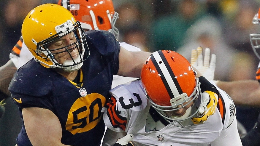 Green Bay Packers' A.J. Hawk (50) is called for a fface mask penalty as he tries to sack Cleveland Browns quarterback Brandon Weeden (3) during the second half of an NFL football game Sunday, Oct. 20, 2013, in Green Bay, Wis. (AP Photo/Mike Roemer)