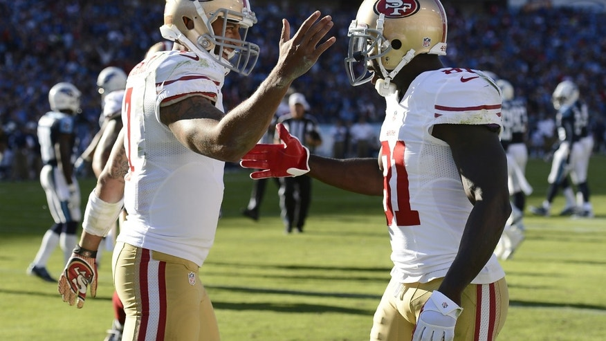 San Francisco 49ers quarterback Colin Kaepernick (7) celebrates with Anquan Boldin (81) after Kaepernick scored a touchdown against the Tennessee Titans on a 20-yard run in the second quarter of an NFL football game on Sunday, Oct. 20, 2013, in Nashville, Tenn. (AP Photo/Mark Zaleski)