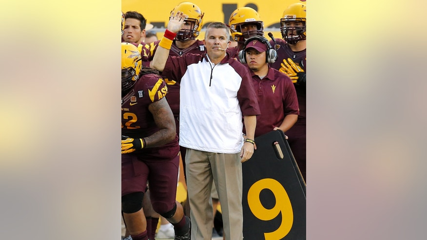 Arizona State head coach Todd Graham makes a call against Washington during the second half of an NCAA college football game, Saturday, Oct. 19, 2013, in Tempe, Ariz. Arizona State won 53-24. (AP Photo/Matt York)
