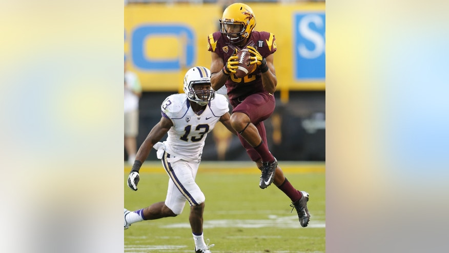 Arizona State wide receiver Kevin Ozier (82) makes the catch as Washington defensive back Will Shamburger (13) defends during the second half of an NCAA college football game, Saturday, Oct. 19, 2013, in Tempe, Ariz. Arizona State won 53-24. (AP Photo/Matt York)