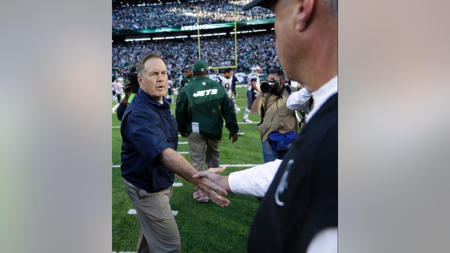 New England Patriots head coach Bill Belichick shakes hands with New York Jets head coach Rex Ryan after an NFL football game Sunday, Oct. 20, 2013 in East Rutherford, N.J. The Jets won the game 30-27. (AP Photo/Seth Wenig)