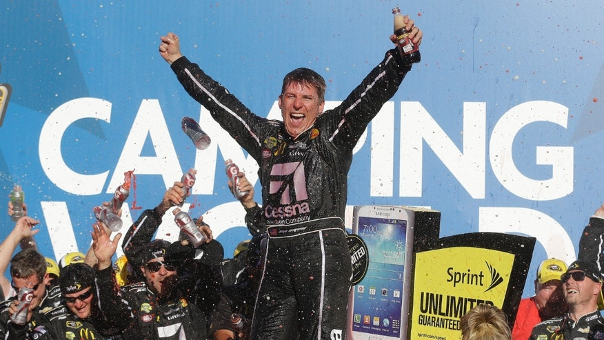Sprint Cup Series driver Jamie McMurray celebrates after winning the NASCAR Sprint Cup Series auto race at the Talladega Superspeedway in Talladega, Ala., Sunday, Oct. 20, 2013.(AP Photo/Jay Sailors)