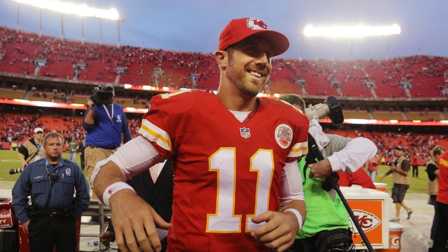Kansas City Chiefs quarterback Alex Smith (11) smiles as he leaves the field following an NFL football game against the Houston Texans at Arrowhead Stadium in Kansas City, Mo., Sunday, Oct. 20, 2013. The Chiefs defeated the Texans 17-16. (AP Photo/Ed Zurga)