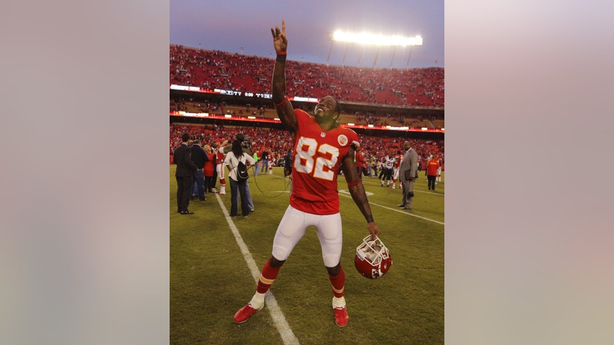 Kansas City Chiefs wide receiver Dwayne Bowe (82) celebrates following an NFL football game against the Houston Texans at Arrowhead Stadium in Kansas City, Mo., Sunday, Oct. 20, 2013. The Chiefs defeated the Texans 17-16. (AP Photo/Ed Zurga)