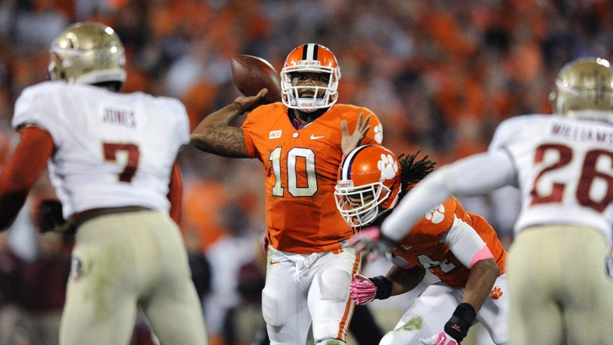 Clemson quarterback Tajh Boyd (10) prepares to throw against Florida State during the first half of an NCAA college football game, Saturday, Oct. 19, 2013, in Clemson, S.C. (AP Photo/Richard Shiro)