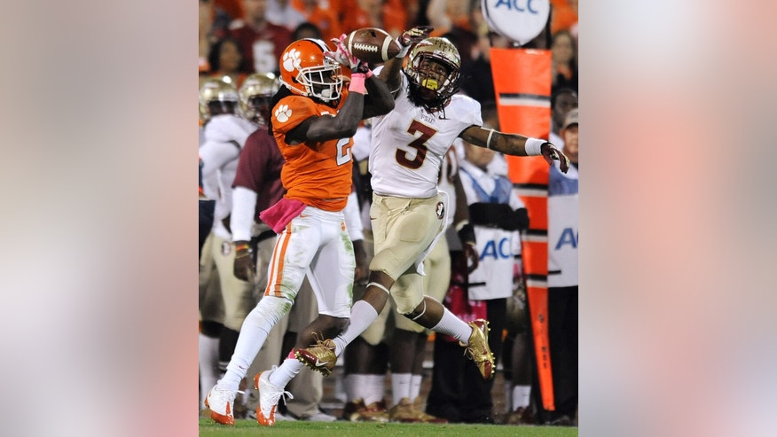 Clemson wide receiver Sammy Watkins (2) tries to make a catch against Florida State defensive back Ronald Darby (3) during the first half of an NCAA college football game, Saturday, Oct. 19, 2013, in Clemson, S.C. (AP Photo/Richard Shiro)