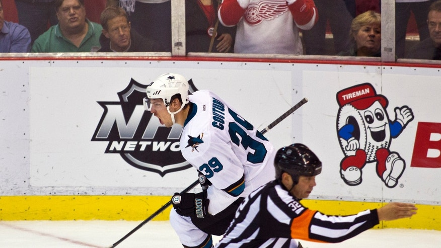 San Jose Sharks forward Logan Couture (39) celebrates his shootout goal after overtime in an NHL hockey game in Detroit, Mich., Monday, Oct. 21, 2013. San Jose won 1-0 on shootouts. (AP Photo/Tony Ding)