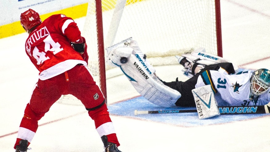 Detroit Red Wings forward Todd Bertuzzi (44) has his shot blocked by the right leg pad of San Jose Sharks goalie Antti Niemi (31), of Finland, during shootouts after overtime in an NHL hockey game in Detroit, Mich., Monday, Oct. 21, 2013. San Jose won 1-0 on shootouts. (AP Photo/Tony Ding)