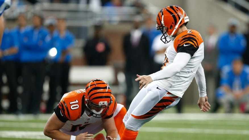 Cincinnati Bengals kicker Mike Nugent (2) kicks a 54-yard field goal out of the hold of Kevin Huber (10) against the Detroit Lions in the fourth quarter of an NFL football game against Sunday, Oct. 20, 2013, in Detroit. Cincinnati beat Detroit 27-24. (AP Photo/Rick Osentoski)