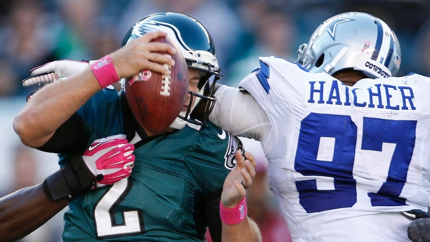 Philadelphia Eagles' quarterback Matt Barkley is pressured by Dallas Cowboys' Jason Hatcher, right, during fourth quarter of an NFL football game on Sunday, Oct. 20, 2013, in Philadelphia. (AP Photo/Philadelphia Daily News, David Maialetti)  THE EVENING BULLETIN OUT, TV OUT; MAGS OUT; NO SALES