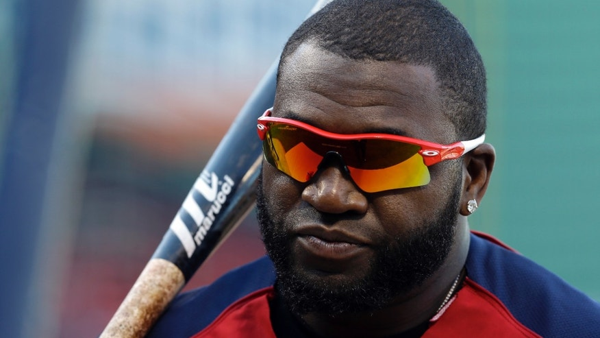 Boston Red Sox's David Ortiz waits to take batting practice during baseball practice Monday, Oct. 21, 2013, in Boston. The Red Sox are preparing to play the St. Louis Cardinals in Game 1 of the World Series on Wednesday. (AP Photo/Darron Cummings)