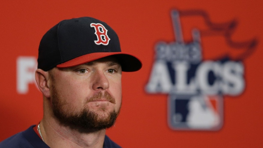 Boston Red Sox's Jon Lester listens to a question during a news conference before Game 4 of the American League baseball championship series against the Detroit Tigers Wednesday, Oct. 16, 2013, in Detroit. Lester is expected to be the Game 5 starter for Boston. (AP Photo/Carlos Osorio)