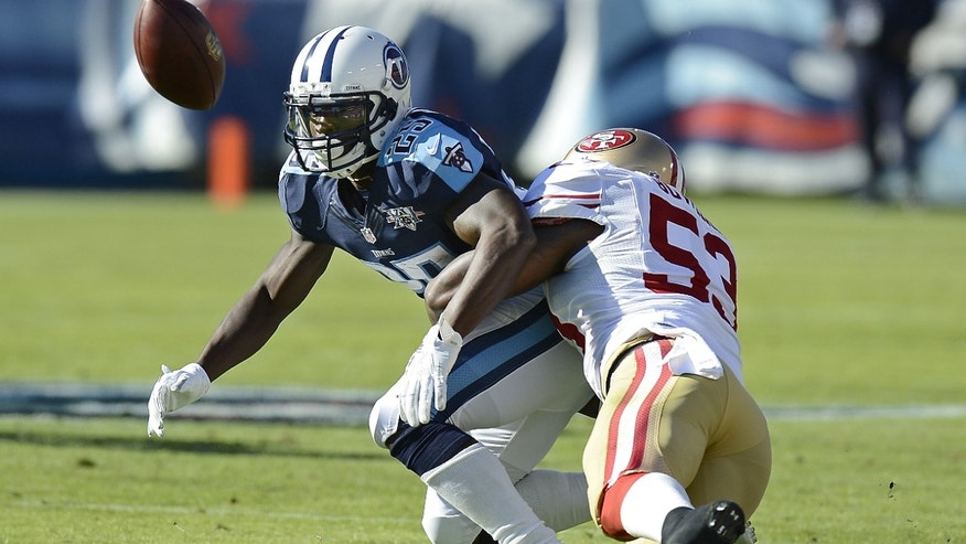 San Francisco 49ers linebacker NaVorro Bowman (53) breaks up a pass intended for Tennessee Titans running back Darius Reynaud (25) in the first quarter of an NFL football game on Sunday, Oct. 20, 2013, in Nashville, Tenn. (AP Photo/Mark Humphrey)