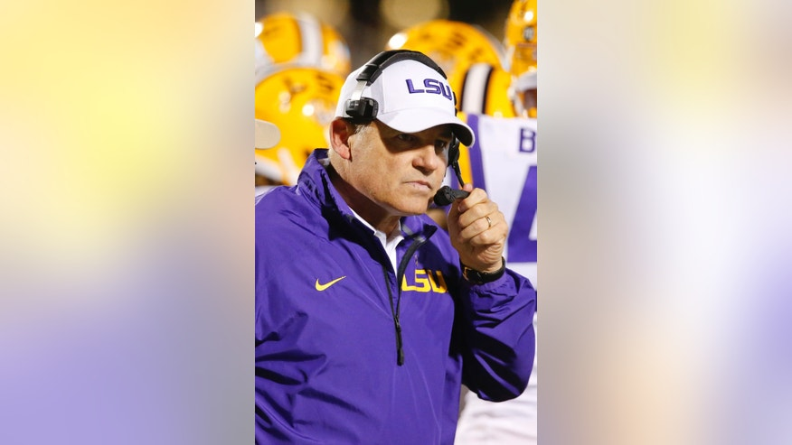 LSU football coach Les Miles talks on his wireless head set in the second half of their NCAA college football game against Mississippi at Vaught-Hemingway Stadium in Oxford, Miss., Saturday, Oct. 19, 2013. Mississippi won 27-24. (AP Photo/Rogelio V. Solis)