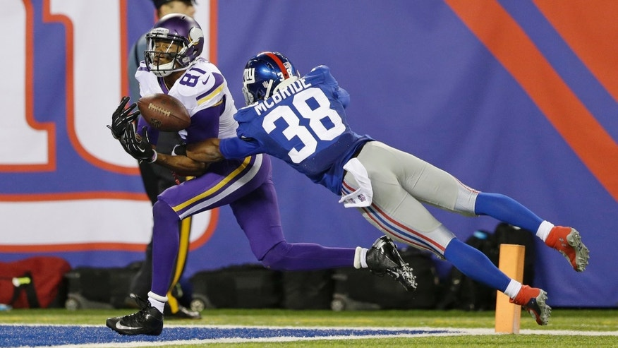 New York Giants cornerback Trumaine McBride (38) breaks up a pass to Minnesota Vikings' Jerome Simpson (81) during the second half of an NFL football game Monday, Oct. 21, 2013 in East Rutherford, N.J. (AP Photo/Julio Cortez)