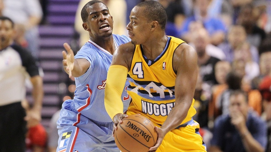 The Los Angeles Clippers' Chris Paul covers the Denver Nuggets' Randy Foye during the first half of a preseason NBA basketball game on Saturday, Oct. 19, 2013, in Las Vegas. (AP Photo/Isaac Brekken)