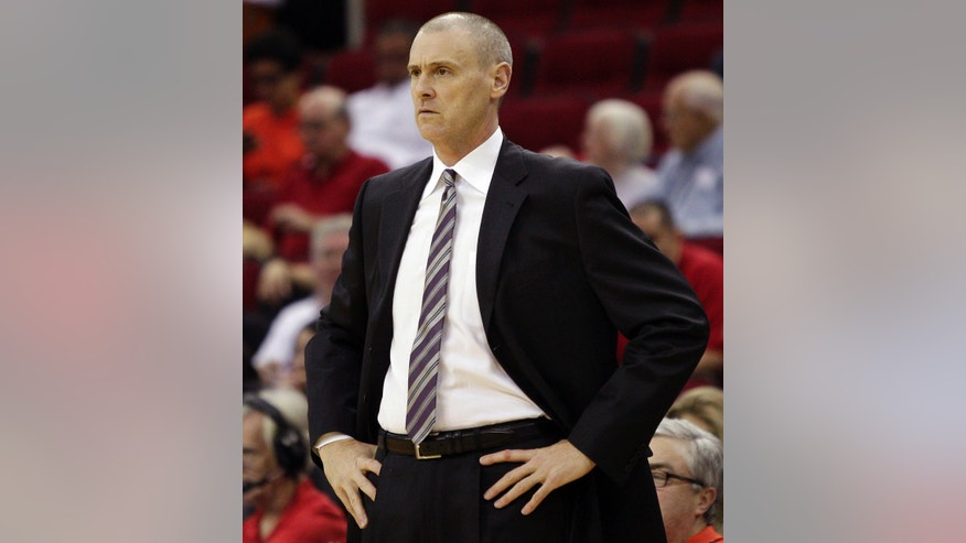 Dallas Maverick's head coach Rick Carlisle looks on from the bench area in the second half of a preseason NBA basketball against the Houston Rocket's game Monday, Oct. 21, 2013, in Houston. Houston won 100-95. (AP Photo/Bob Levey)