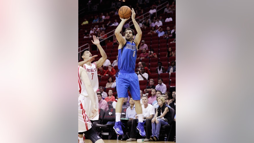 Dallas Maverick's Jose Calderon, right,  shoots over Houston Rocket's Jeremy Lin, left, in the second half of a preseason NBA basketball game Monday, Oct. 21, 2013, in Houston. Houston won 10-95. (AP Photo/Bob Levey)