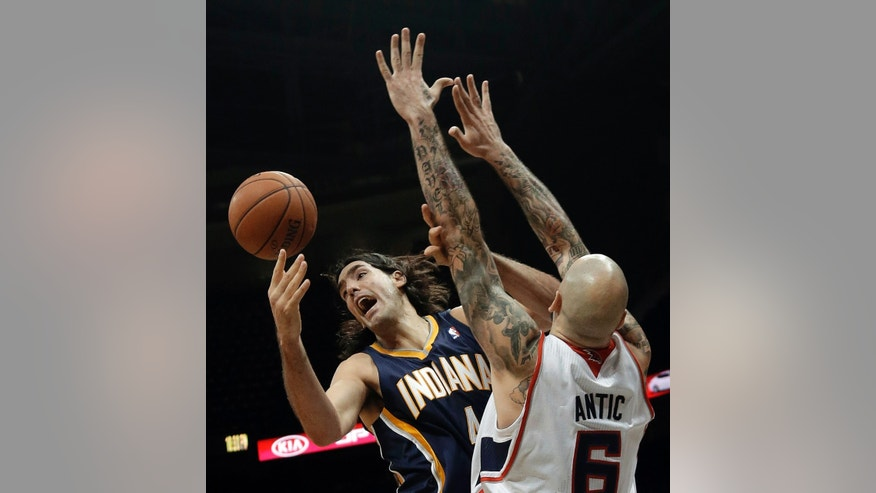 Indiana Pacers power forward Luis Scola (4), of Argentina, loses control of the ball as Atlanta Hawks power forward Pero Antic (6) defends in the first half of a preseason NBA basketball game Tuesday, Oct. 22, 2013, in Atlanta. (AP Photo/John Bazemore)