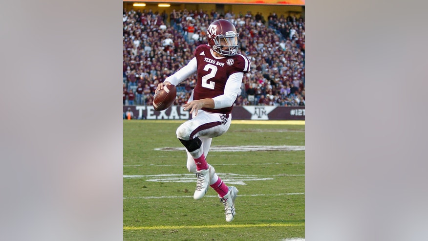 Texas A&M quarterback Johnny Manziel (2) rushes for a 1-yard score in the fourth quarter against Auburn during an NCAA college football game Saturday, Oct. 19, 2013, in College Station, Texas. Auburn won 45-41. (AP Photo/Bob Levey)