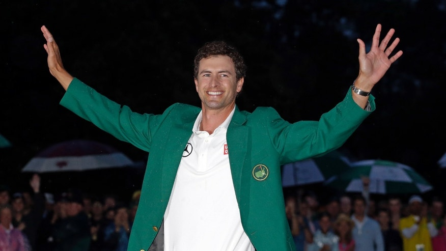 FILE - In this April 14, 2013 file photo, Adam Scott, of Australia, celebrates with his green jacket after winning the Masters golf tournament in Augusta, Ga. Scott considers his 20-foot birdie putt on the 18th green the signature moment of his career, even if it wasn't the putt that made him the first Australian to win the Masters. (AP Photo/Matt Slocum, File)